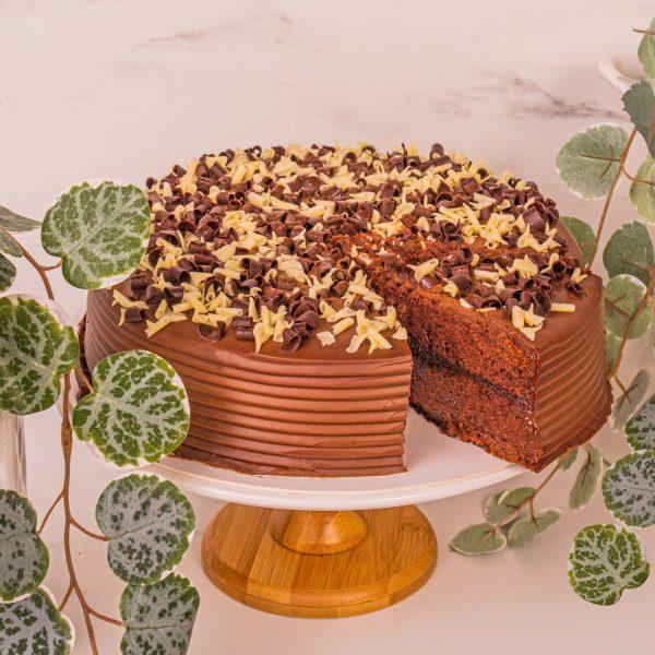 chocolate fudge cake sliced by mori cakes