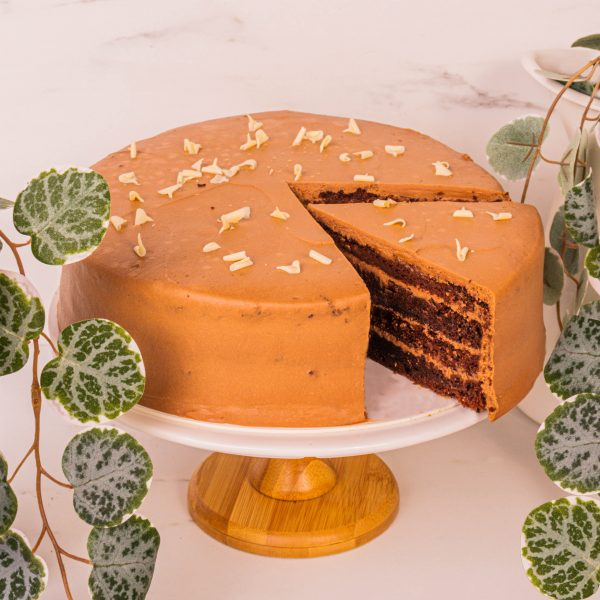 dark chocolate cake sliced by farm florist